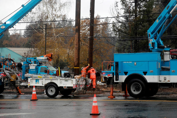 Pacific Gas & Electric works on power lines to repair damage caused by the Camp Fire in Paradise, California, November 21, 2018.