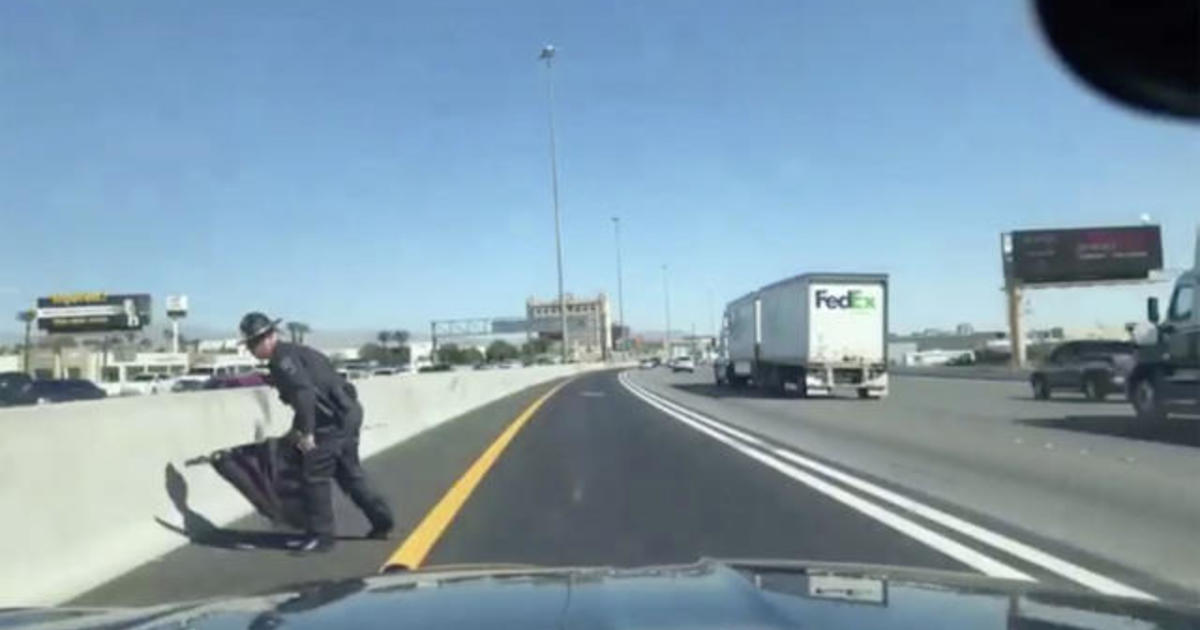 Trooper pulls over to save flag from highway