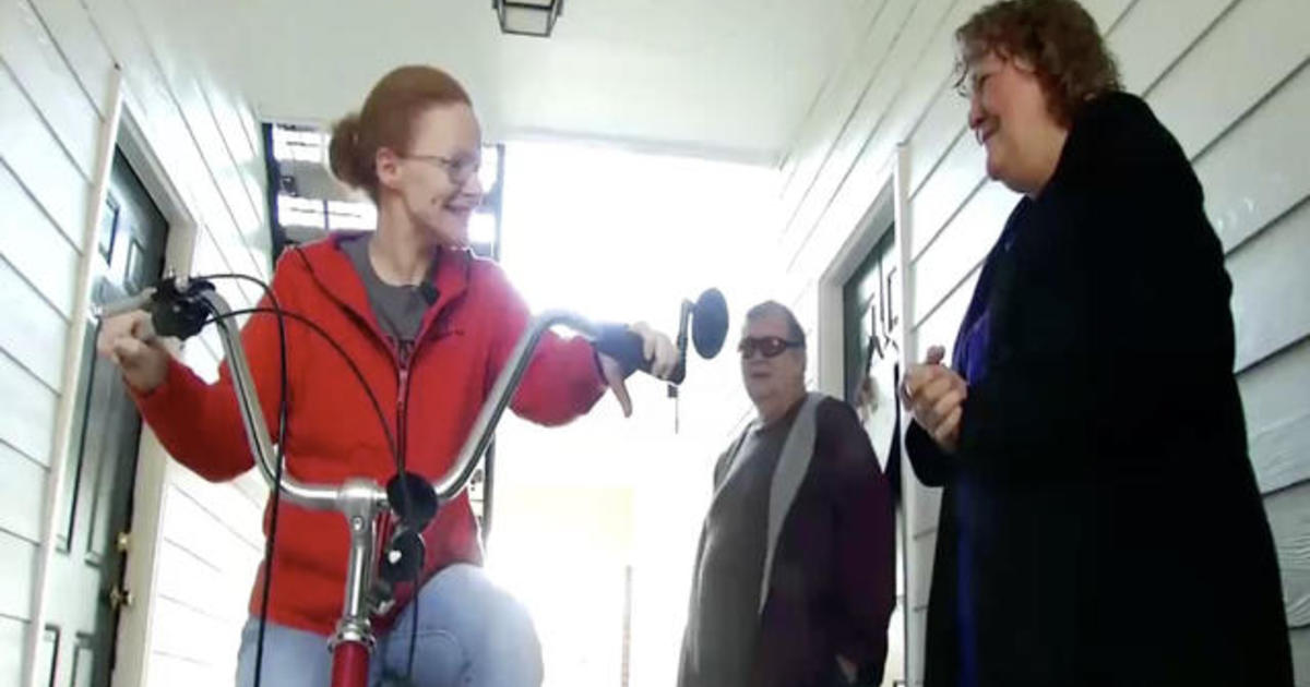 Couple gifts woman with limited mobility a new tricycle