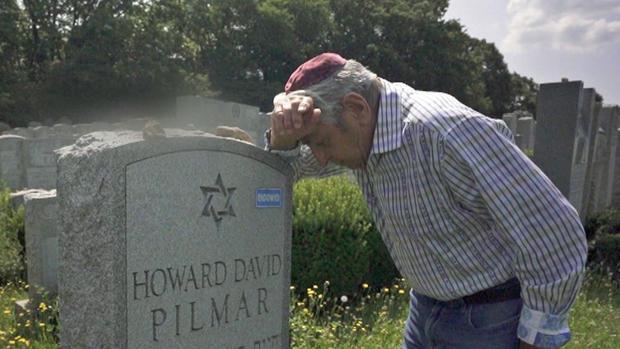 Frank Pilmar at son's grave