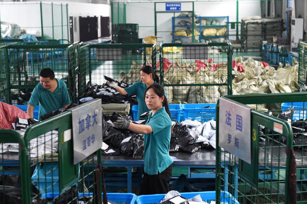 Workers sort international parcels at a cross-border e-commerce industrial park ahead of the Singles Day online shopping festival in Hefei