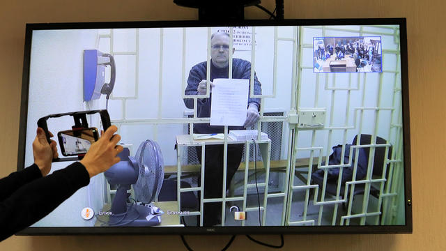 Former U.S. marine Whelan is seen on a screen via a video link during a court hearing in Moscow