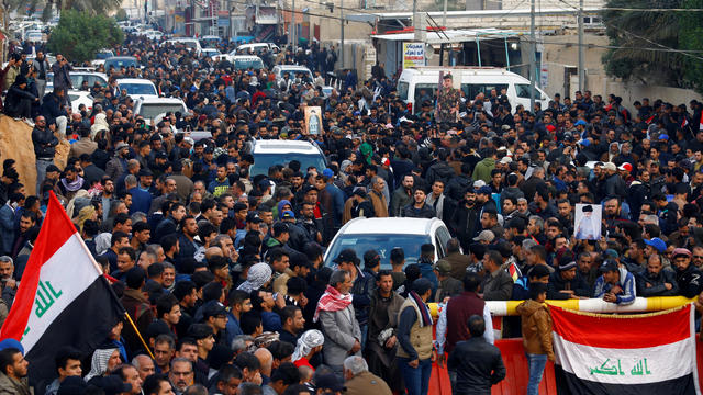 Supporters of Iraqi Shi'ite cleric Moqtada al-Sadr gather near his home, after it was attacked, in the holy city of Najaf