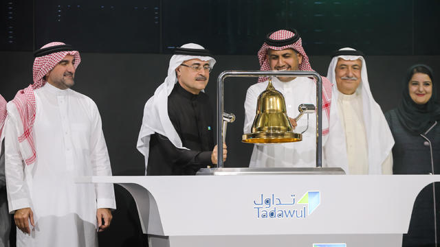 Amin H. Nasser, President and CEO of Aramco, rings the bell during the official ceremony marking the debut of Saudi Aramco's initial public offering (IPO) on the Riyadh's stock market, in Riyadh