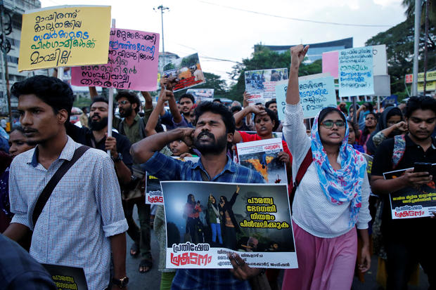 Demonstrators shout slogans during a protest march to show solidarity with the students of New Delhi's Jamia Millia Islamia university, in Kochi