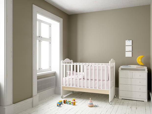 Modern nursery room with blank frame