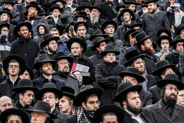 Orthodox Jews take part in the 13th Siyum HaShas, a celebration marking the completion of the Daf Yomi, a seven-and-a-half-year cycle of studying texts from the Talmud, the canon of Jewish religious law, at MetLife Stadium in East Rutherford, New Jersey,