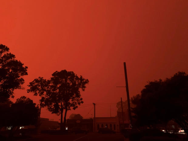 The sky glows red as bushfires continue to rage in Mallacoota, Victoria, Australia