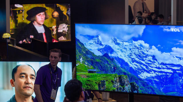 QLED 8K televisions are seen at the TCL exhibit at the the Las Vegas Convention Center during CES 2019 in Las Vegas on January 8, 2019.