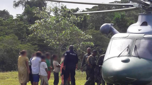 Police officer approaches persons allegedly responsible for the deaths of seven people, in Bocas Del Toro