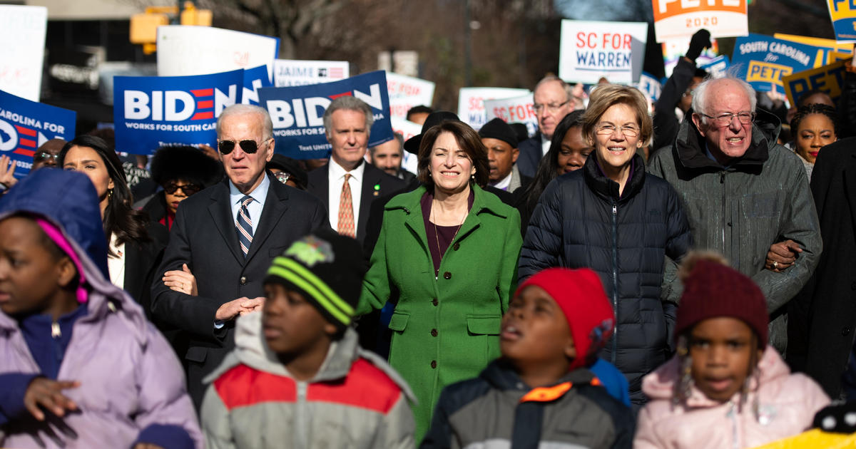2020 Democratic candidates link arms on Martin Luther King Jr. Day