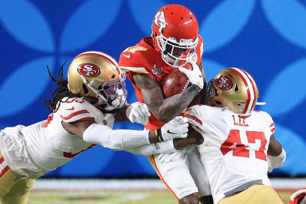 Super Bowl 2020: Mecole Hardman #17 of the Kansas City Chiefs is tackled by Marcell Harris #36 and Elijah Lee #47 of the San Francisco 49ers
