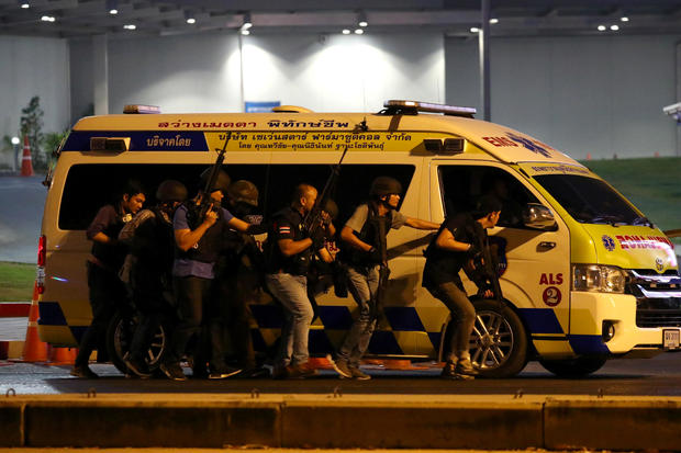 Thailand security forces take cover behind an ambulance as they chase a shooter hidden in a shopping mall after a mass shooting in front of the Terminal 21, in Nakhon Ratchasima, Thailand February 9, 2020. (Credit: Athit Perawongmetha / Reuters)