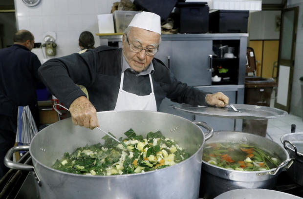 Dino Impagliazzo, Rome's 90-year-old 'chef of the poor', prepares food for the homeless