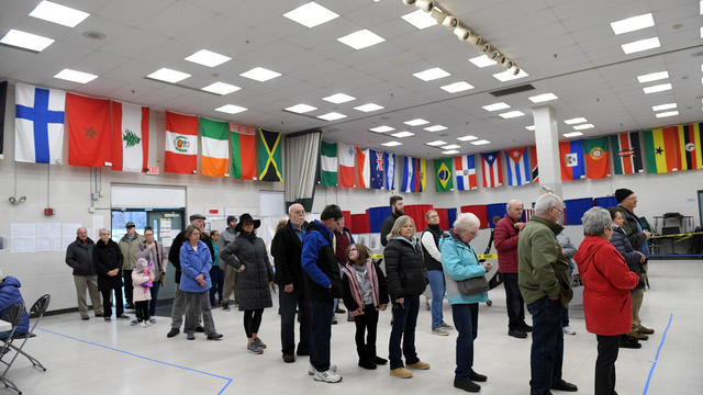 Voters wait in line to cast their votes at the Bicentennial Elementary School in New Hampshire's first-in-the-nation U.S. presidential primary election in Nashua