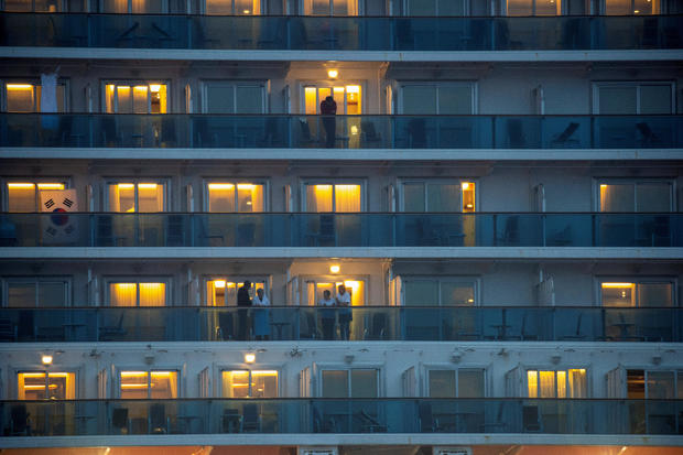 Passengers are seen at the cruise ship Diamond Princess, where dozens of passengers were tested positive for coronavirus, at Daikoku Pier Cruise Terminal in Yokohama