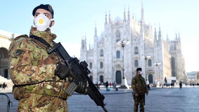 Military officers stand outside Duomo cathedral in Milan