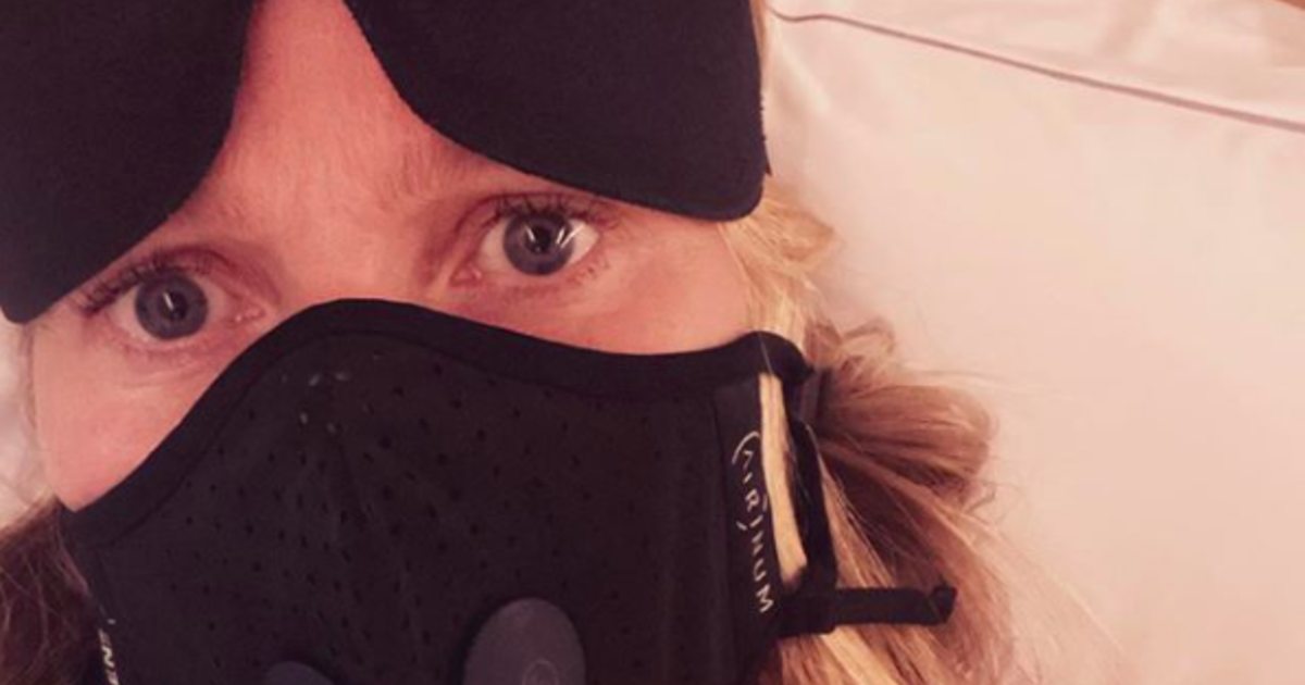 """Gwyneth Paltrow, star of """"Contagion,"""" posts photo wearing a face mask on a plane: """"I've already been in this movie"""""""