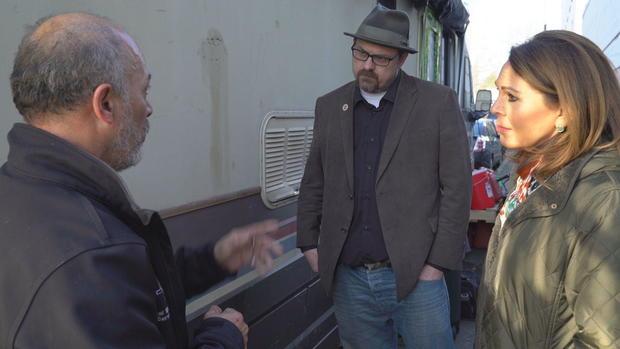 graham-pruss-salinas-speaking-to-homeless-person-living-in-rv-in-ballard-seattle.jpg