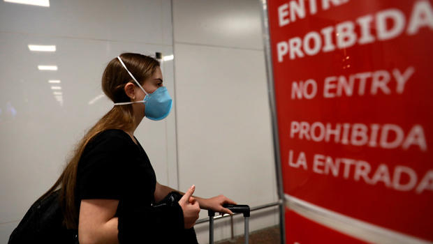 Traveller, wears a mask as a precautionary measure due to the coronavirus, is seen at Salgado Filho airport in Porto Alegre