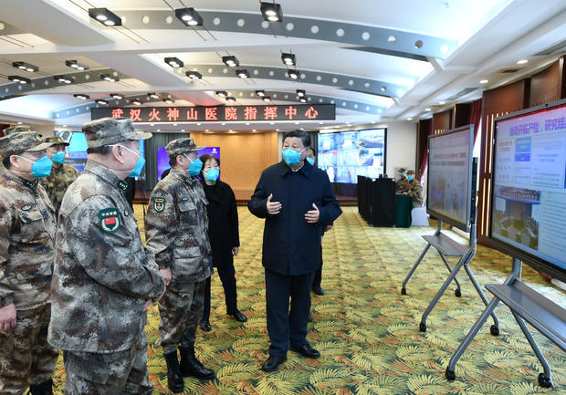 Chinese President Xi learns about the hospital's operations, treatment of patients, protection for medical workers and scientific research at the Huoshenshan Hospital in Wuhan