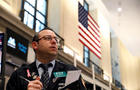 Traders work on the trading floor of the Amex Futures market at the New York Stock Exchange (NYSE) in New York