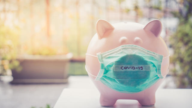 Piggy bank with Face Mask, Financial crisis and market crash due to coronavirus