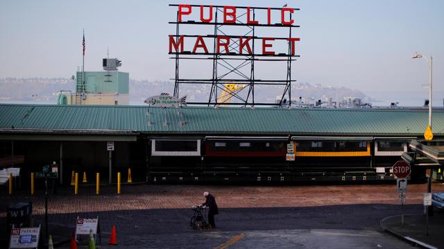 A woman walks through empty streets outside the Public Market, amid the coronavirus disease outbreak, in Seattle