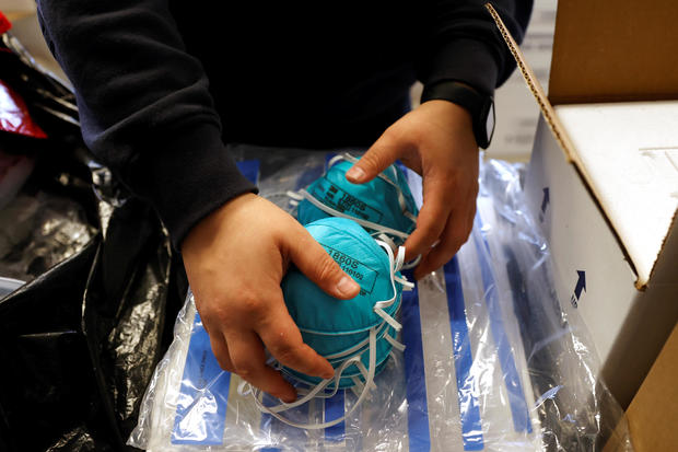 Emergency Medical Technician Emma Vargas prepares N95 protective masks for use by medical field personnel at a New York State emergency operations center in New Rochelle