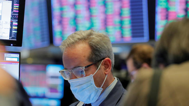A trader smiles on Jan. 2, 2013, on the trading floor of the New York Stock Exchange in New York.