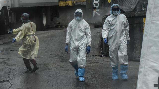 Mobile Morgues Set Up Outside Brooklyn Hospital As Coronavirus Outbreak Hits New York
