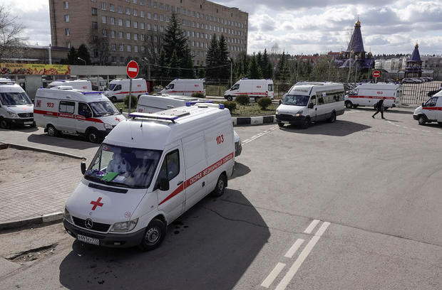 Ambulances queue before driving onto the adjacent territory of a local hospital in Khimki