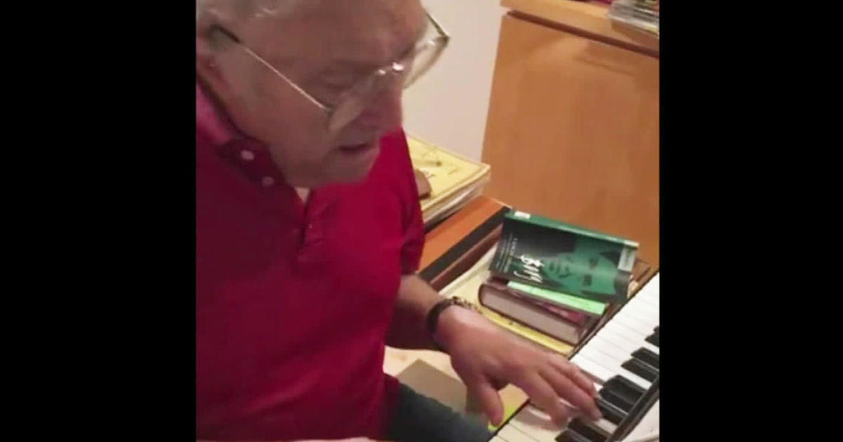 """Photo of Randy Newman has a message: """"Stay Away"""" 