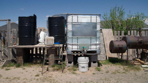 A water tank in the backyard of an elderly Navajo woman whose home lacks running water. CBS News