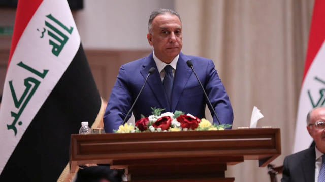 Iraqi Prime Minister-designate Mustafa al-Kadhimi delivers a speech during the vote on the new government at the parliament headquarters in Baghdad