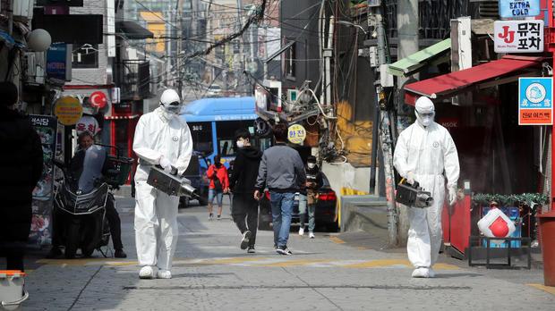 Quarantine workers spray disinfectants at night spots of Itaewon neighborhood, following the coronavirus disease (COVID-19) outbreak, in Seoul