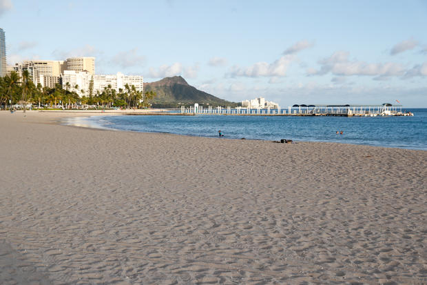 FILE PHOTO: Waikiki Beach is nearly empty due to the business downturn caused by the coronavirus disease (COVID-19) in Honolulu