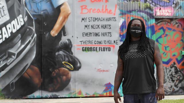 Virus Outbreak Texas Floyd Mural