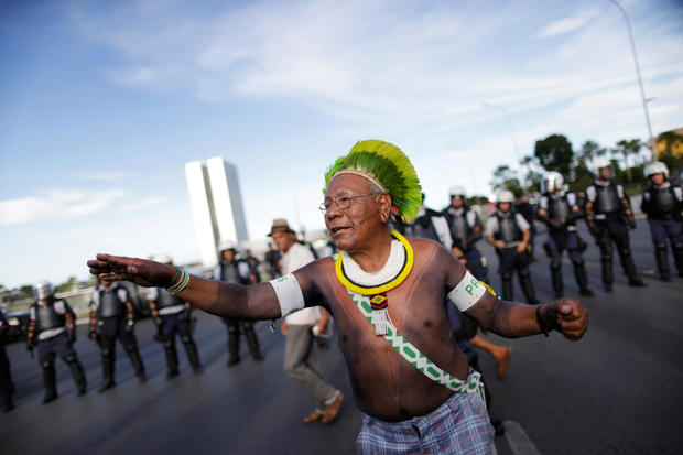 Indigenous leader Paulinho Paiakan of Kayapo tribe, takes part a protest against Brazil's president Michel Temer for the violation of indigenous people's rights, in Brasilia