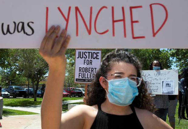 Demonstrators participate in a protest rally for Robert Fuller in Palmdale