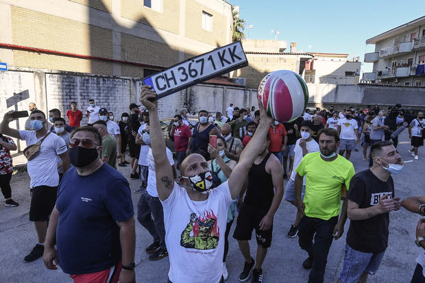 Neighborhood people protest against residents living in a