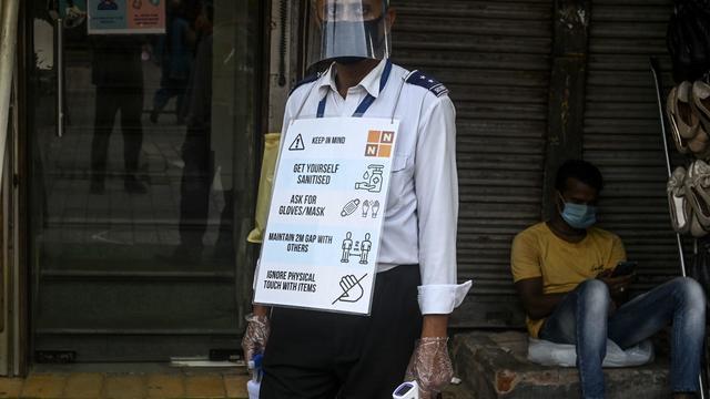 INDIA-HEALTH-VIRUS-ECONOMY