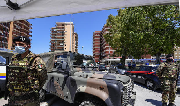 Italian police and Army personnel surround the red zone,