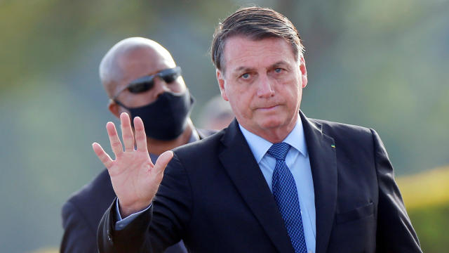 Brazil's President Jair Bolsonaro gestures before a national flag hoisting ceremony in front of Alvorada Palace, amid the coronavirus outbreak in Brasilia, Brazil, June 9, 2020.