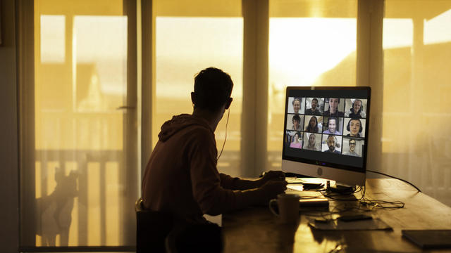 Young man distracted while on  video call from his home during lockdown
