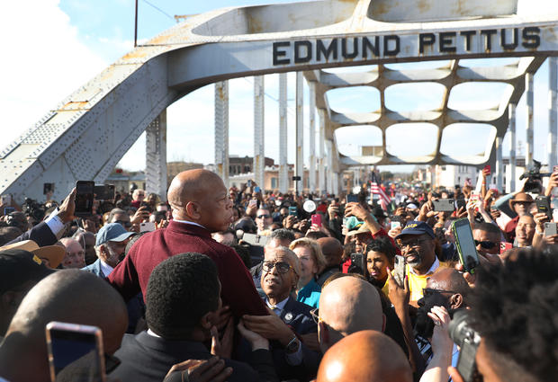 Presidential Democratic Candidates March Across Edmund Pettus Bridge Marking 55th Anniversary Of Selma's Bloody Sunday