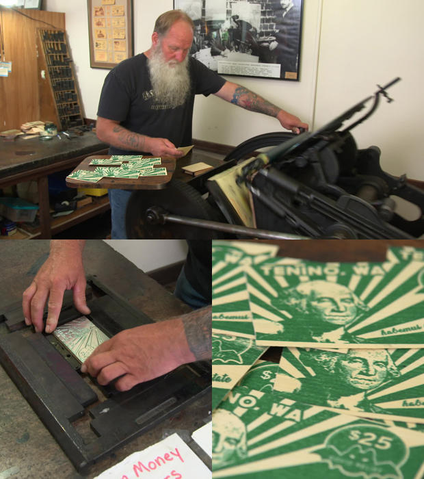 loren-ackerman-operates-printing-press-to-creater-wooden-currency.jpg