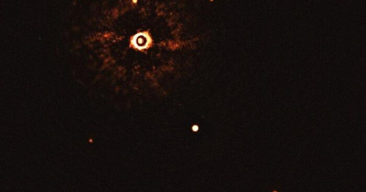 Scientists reveal first-ever photo of a solar system like ours
