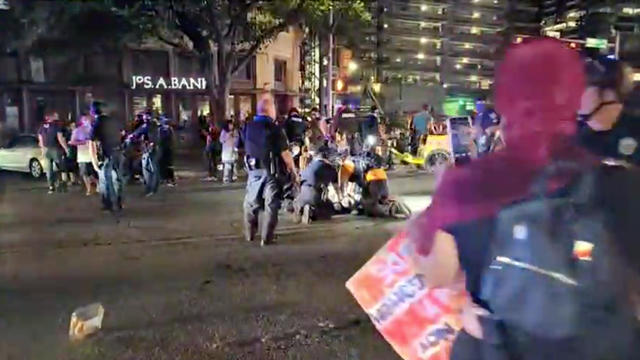 Police and protesters gather around a demonstrator who got shot during a Black Lives Matter protest in downtown Austin, Texas