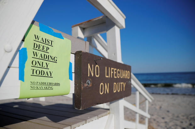 A sign announces that swimming is restricted to waist deep wading in Cape Elizabeth